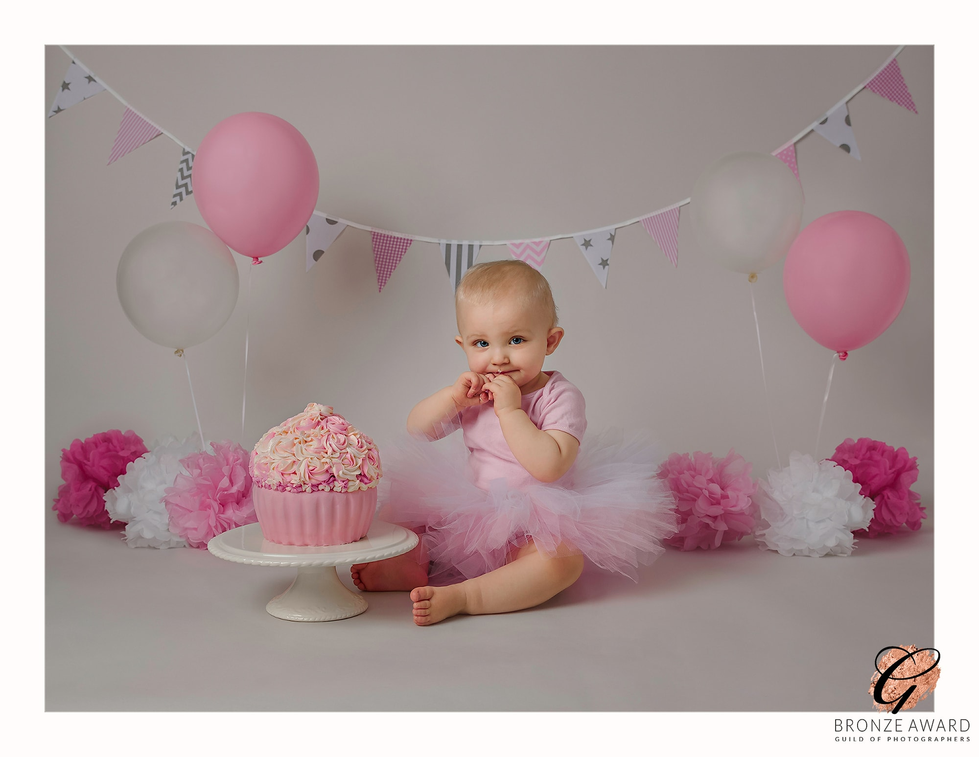 blog image of baby girl in pink tutu with cake how to prepare for cake smash photoshoot in hurstpierpoint