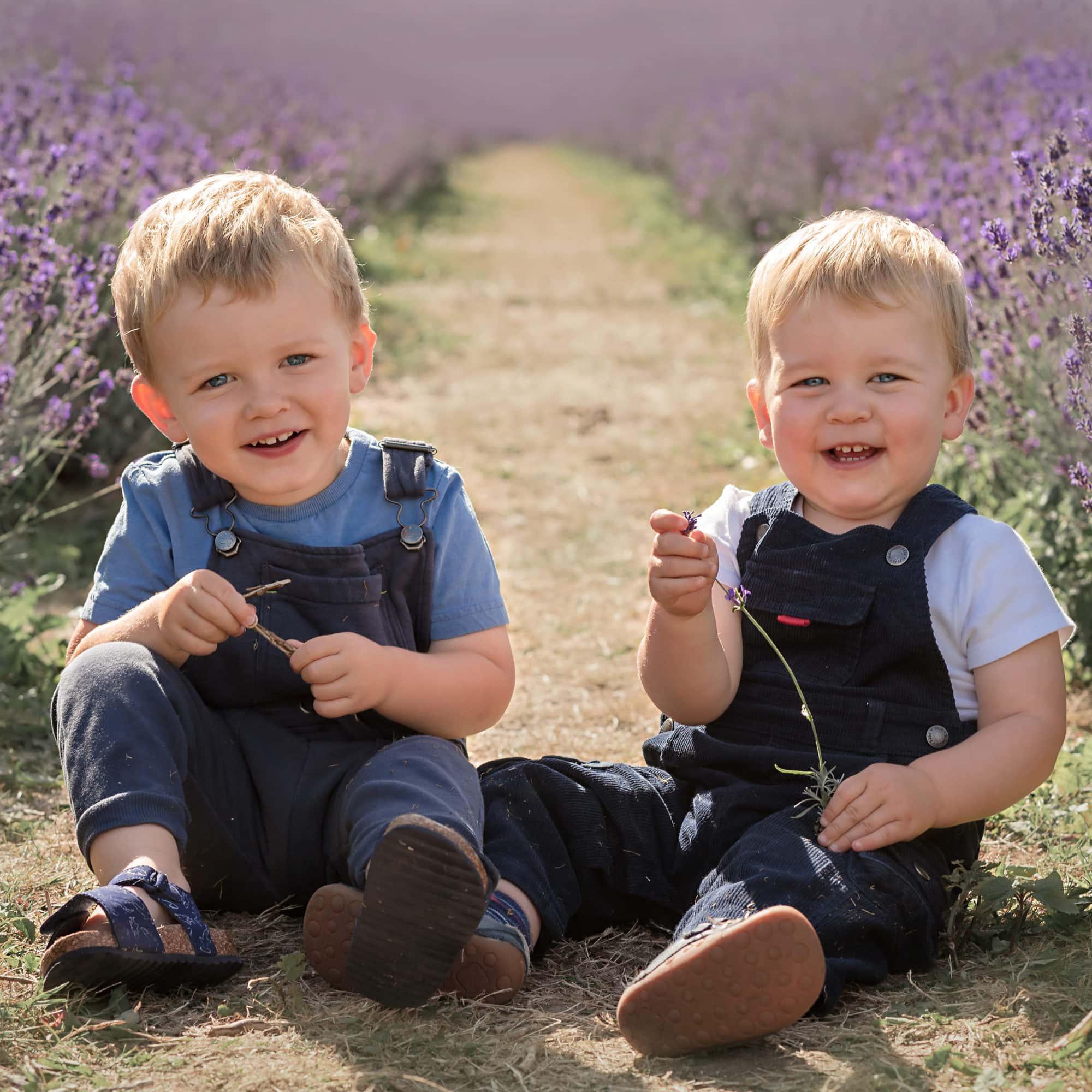 hurstpierpoint photographer boys sat in lavender fields square crop